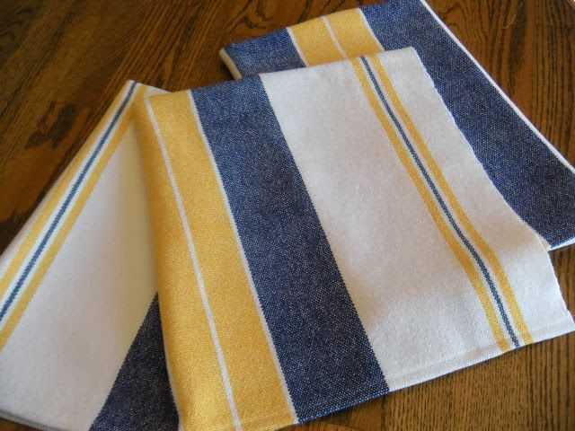Yellow, blue and crisp white cotlin yarns woven into some Scandinavian inspired towels.   Stripes woven in bright colors on a white b...