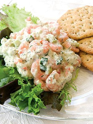 Shrimp Salad  8-oz pkg frozen cooked salad shrimp, thawed and drained  6-oz can lump crabmeat, drained and picked  1  large hard-cooked egg, grated  1/4  c chopped celery  2  tbs minced green onion  2  tsp dried dill weed  1/4  tsp salt  4  tbs mayonnaise  3  tbs sour cream