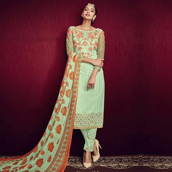 Leave a long-lasting impression on your onlookers with this green boat neck pattern designer salwar suit. The floral embroidery & lace work within the attire make it ideal for parties, functions & festivals. It comes along with a matching santoon bottom & chiffon printed dupatta.