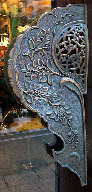Exotic handle on Venice shop door.
