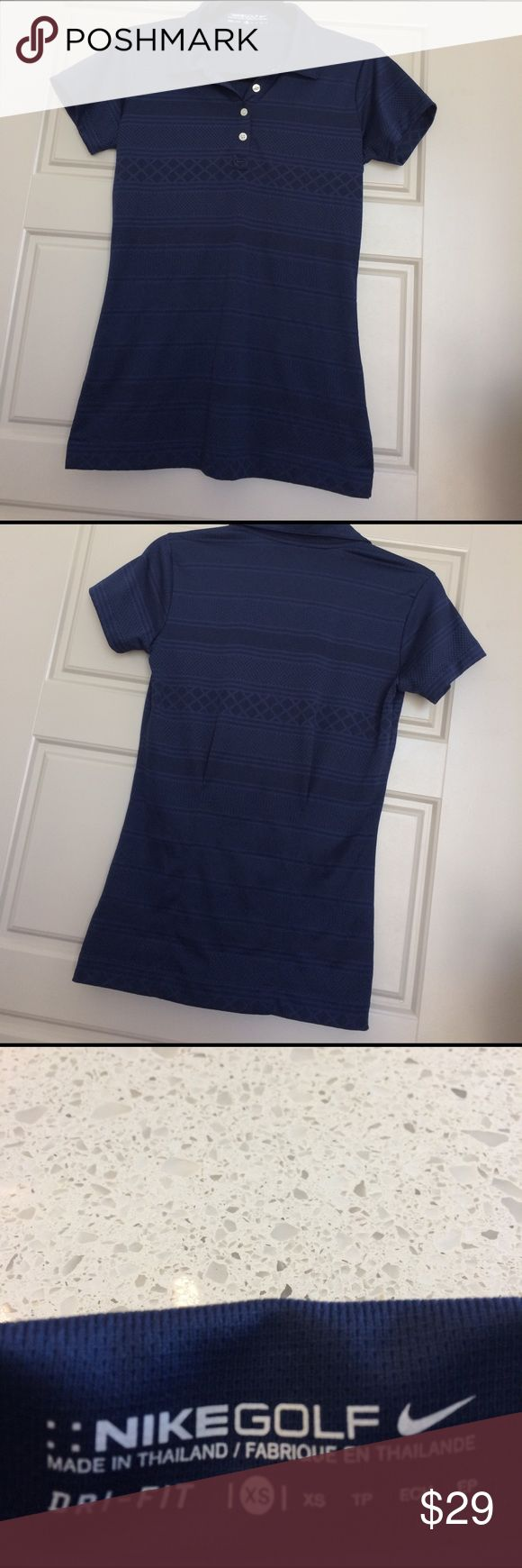 NIKE golf shirt XS Nike dri-fit Golf shirt size XS worn once -like new....gorgeous breathable material navy color women's gold shirt with pleates in the back to make it more form fitting Nike Tops