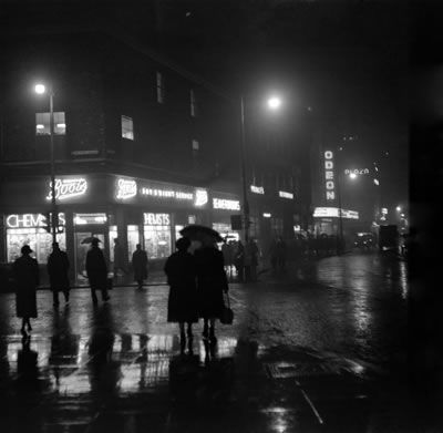 Fog in Manchester turns day into night here is the scene at 1.30pm in Oxford Street, Manchester, Greater Manchester. 17th November 1953