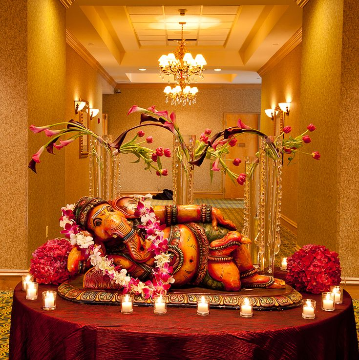 Indian weddings entrance decor escort cards table for Indian home wedding decorations