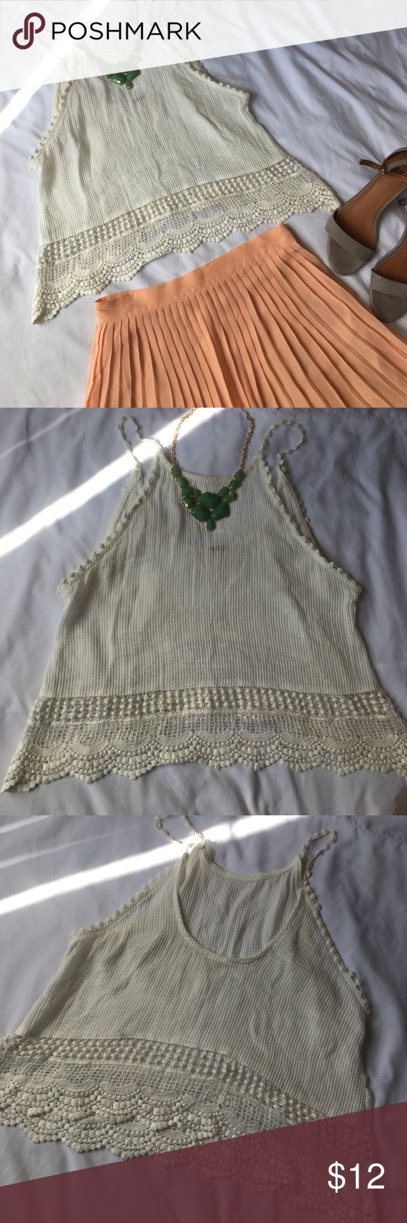 Crop top Cute embroidered crop top, NWOT, never been worn. Could be worn with a maxi dress or simply some distress light wash jeans and cute high heel sandals. Brand is proof. Not forever 21, tagged for exposure. Featured shoes are also for sale. Forever 21 Tops Crop Tops
