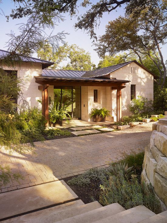 Great hill country style sort of frank lloyd wright for Modern house exterior remodel