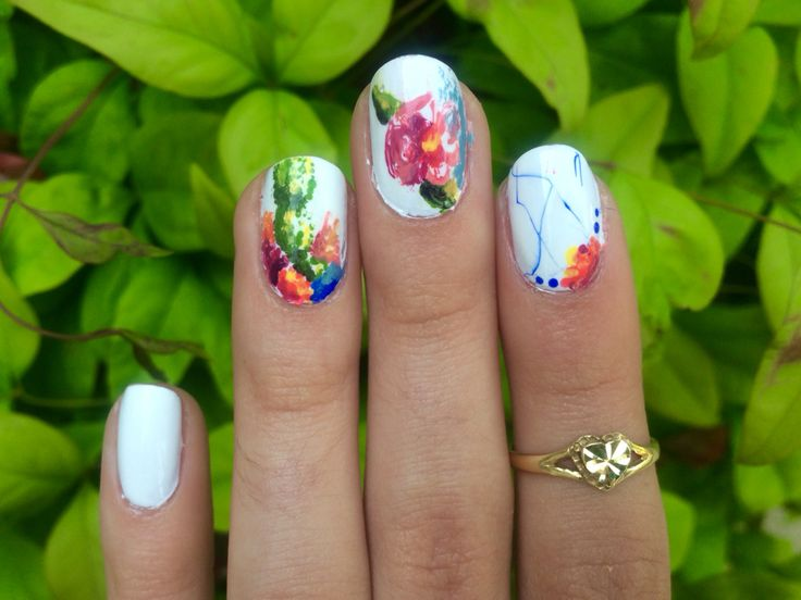 Floral cactus fiesta nails on Sally Hansen white by Katelyn Watkins.