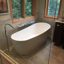 Ready to soak up this earthy bathroom renovation? First step, find your centerpiece, the bathtub. Specifically a Badeloft freestanding bathtub. Perfect for bathroom upgrades, renovations, and bathroom upgrades.