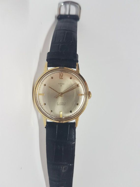 Timex Viscount Mens Watch 1968 Light Gold Dial Automatic 21 Jewel Movement  Dial condition and detail: Excellent light Gold with raised Gold markers and Gold hands Great Britain  Case condition and detail: Excellent Timex Great Britain Stainless Steel Back  Movement type and functions: Automatic Sets, winds and runs fine, keeps time  Crystal/Glass condition: Few Scrtaches- will try to find a replacement!  Strap condition and detail: Black- good condition!  Size of watch: Width not includ...