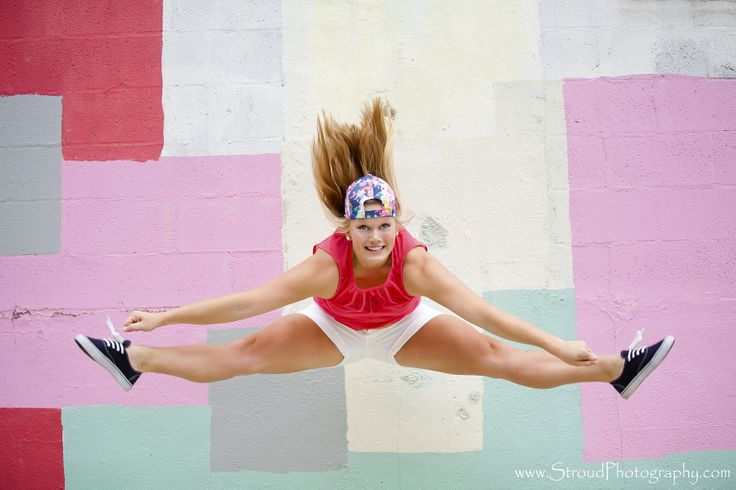 Toe touch this senior cheerleader had tons of fun showing for Cheerleader wall mural