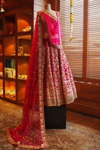 Bridal Lehengas - Hot Pink Bridal Lehenga with Heavy Gold Zardosi Work and Pink Net Dupatta with Scattered Motifs | WedMeGood #wedmegood #bridal #lehengas
