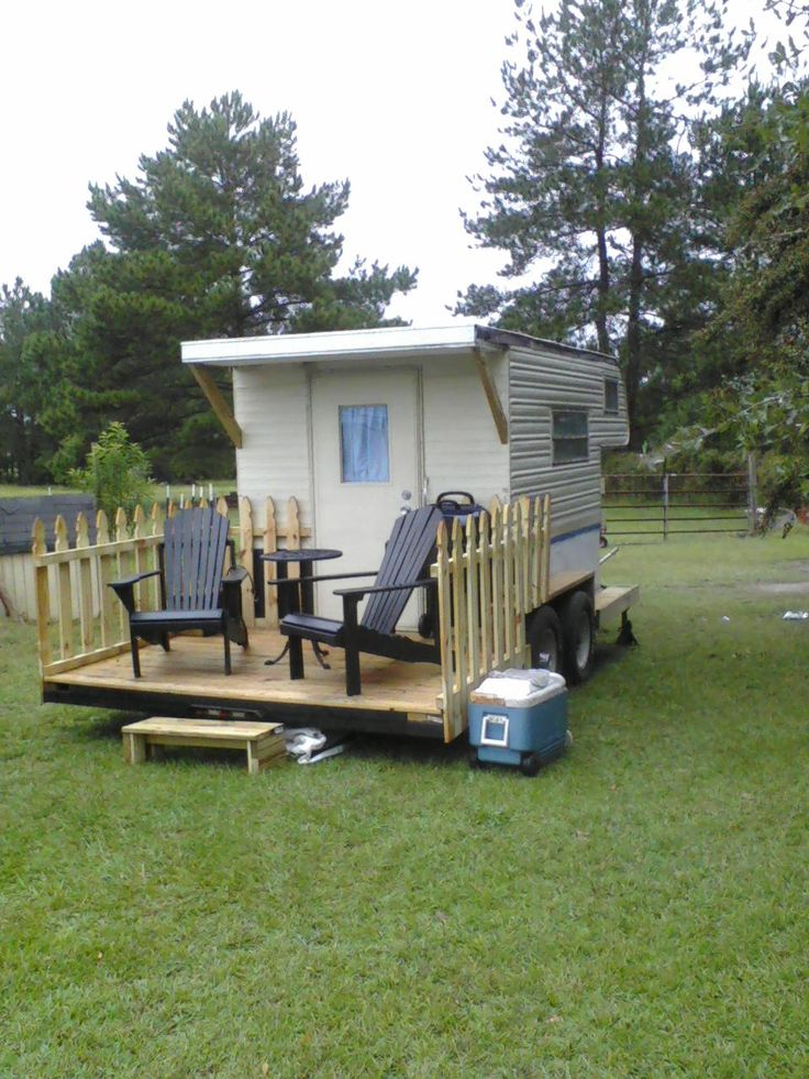 Love the deck behind the cab over camper. Build something like this at relatives house for when we visit!