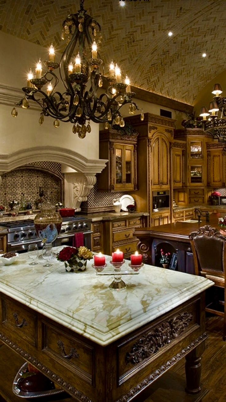 Kitchen is high end, a bit too ornate for my taste, but love the chandeliers!
