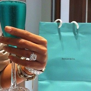 You can also match your celebratory bubbly to your ring box or bag. | 29 Engagement Ring Photo Ideas You'll Want To Say Yes To
