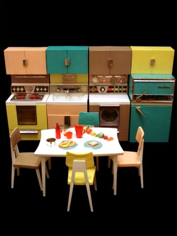 My older cousin's Barbie Kitchen. With the oven that lighted up. The glasses half full of milk. Every single thing moved. This may be the single best toy I ever played with.