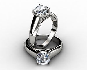 Lucida Wide Band Round Brilliant Cut Solitaire Engagement Ring Love the wide plat band. One stone.
