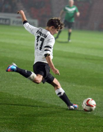 louis tomlinson in a charity soccer game<3 I think this just made him 10X more attractive!