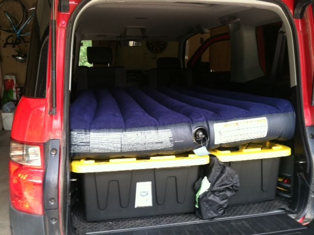 Air mattress rests directly on tops of storage boxes