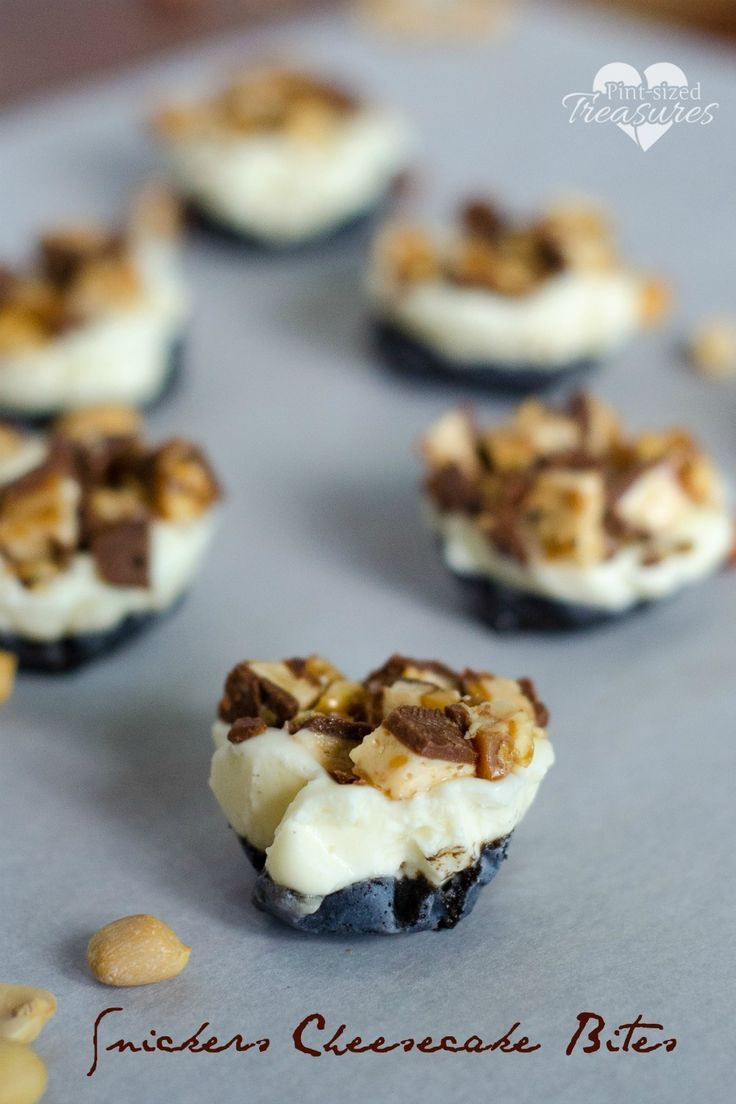 Snickers cheesecake bites are super-easy and have a fun crust for an added twist! Serve these cheesecake bites frozen for a frozen treat! Little mess, little fuss and LOTS of taste! #cheesecake #nobake #desserts #easydesserts