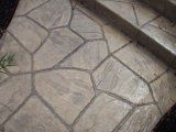 stamped concrete porch and walkway, with river rock landscaping