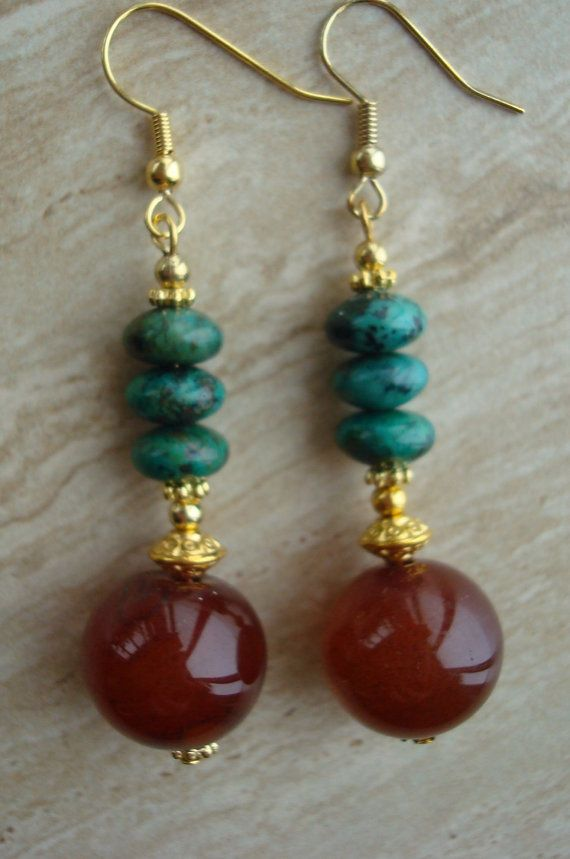 Dangle gemstone earrings featuring14MM round carnelian beads accented with turquoise rondelle beads. Ear wires are Vermeil.