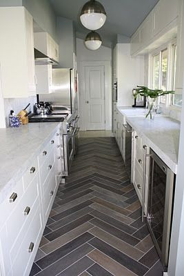 Galley Kitchen -- carrara marble, slate herringbone tile, hicks pendants