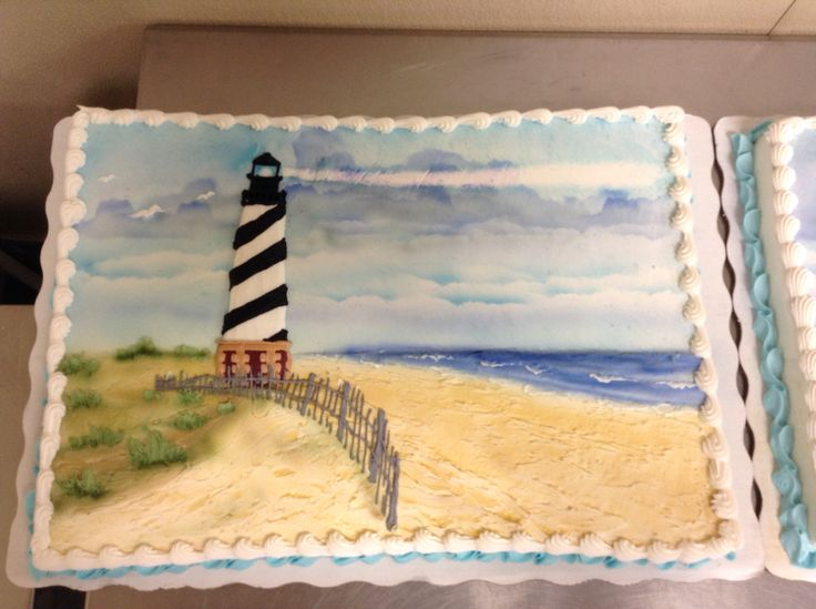 full sheet cake of Cape Hatteras Lighthouse airbrushed and decorated in buttercream icing