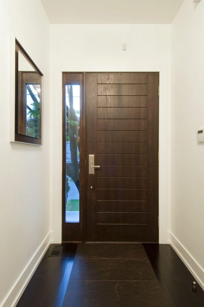 Tone on tone tile and hardwood entry floor inspiration for Hardwood entrance doors