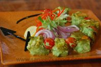 Dhaniya Paneer Kabab: Paneer cubes marinated in coriander chutney and cooked to perfection.