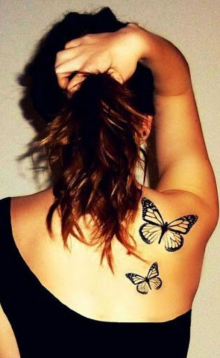 Butterfly tattoo. Love the placement here!
