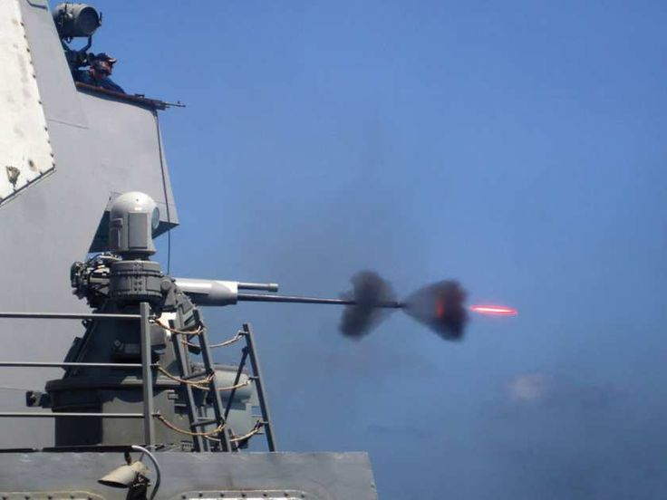 GULF OF ADEN,Feb.28,2011.MK-38 25mm gun fired during live-fire exercise aboard guided-missile destroyer USS Mason (DDG 87). (U.S. Navy photo by Mass Communication Specialist 3rd Class Jeffry A. Willadsen/Released)