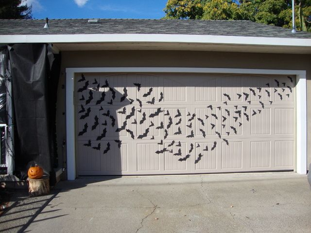 Halloween Forum member bat swarm. Foam sheet bats cut out..glued tiny magnets to back..attach to garage door. Simple, inexpensive, great idea!