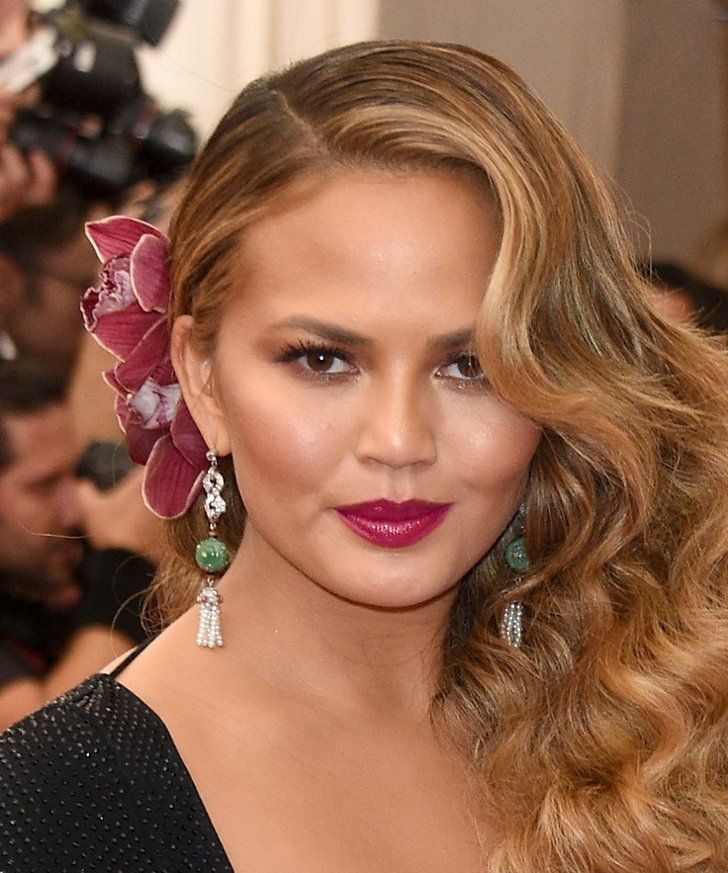 Pin for Later: Zoom In on Every Gorgeous Hair Accessory From the Met Gala Chrissy Teigen Chrissy's floral hair accents precisely matched her plum lip on the Met Gala red carpet.