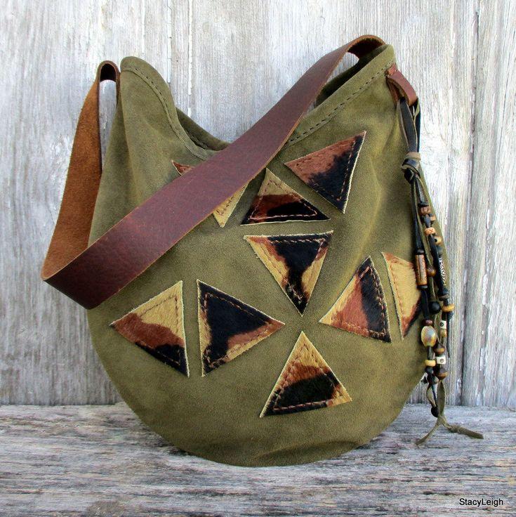 Leather Handbag in Geometric Triangles, Suede Leather Shoulder Bag by Stacy Leigh in Olive Green Soft Italian Calf Suede and Hair on Cowhide Oval shaped leather shoulder bag in a soft, olive/army green suede leather. The front of the bag has 9, hair on, tri-color, cowhide, triangles that