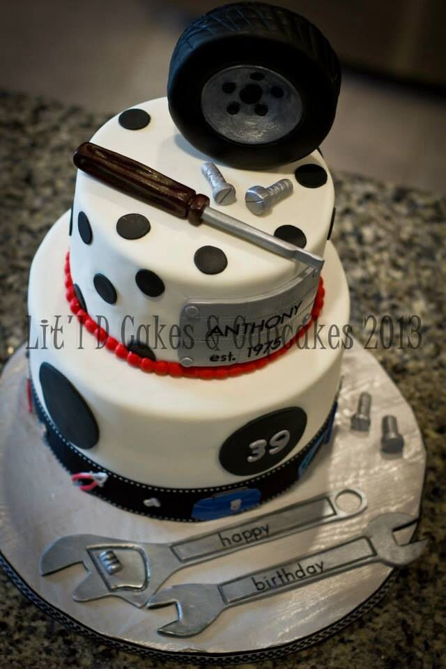 Created by; Lit'l D Cakes & Cupcakes Automotive cake, tools and tires all handmade and edible.