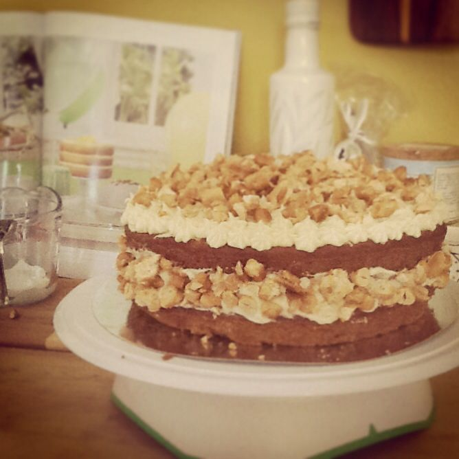 Pumpkin spice cake with cream cheese frosting and candied peanuts