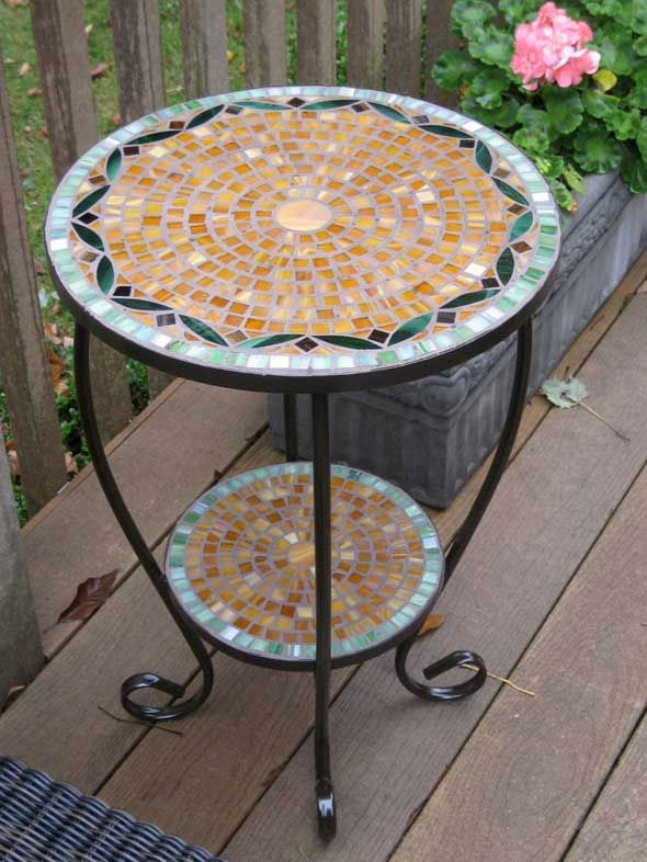 Very pretty two tiered mosaic table.