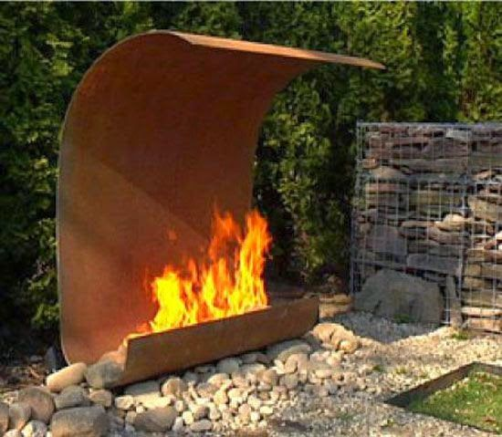 Modern Outdoor Fireplace...this could be made with car parts etc...