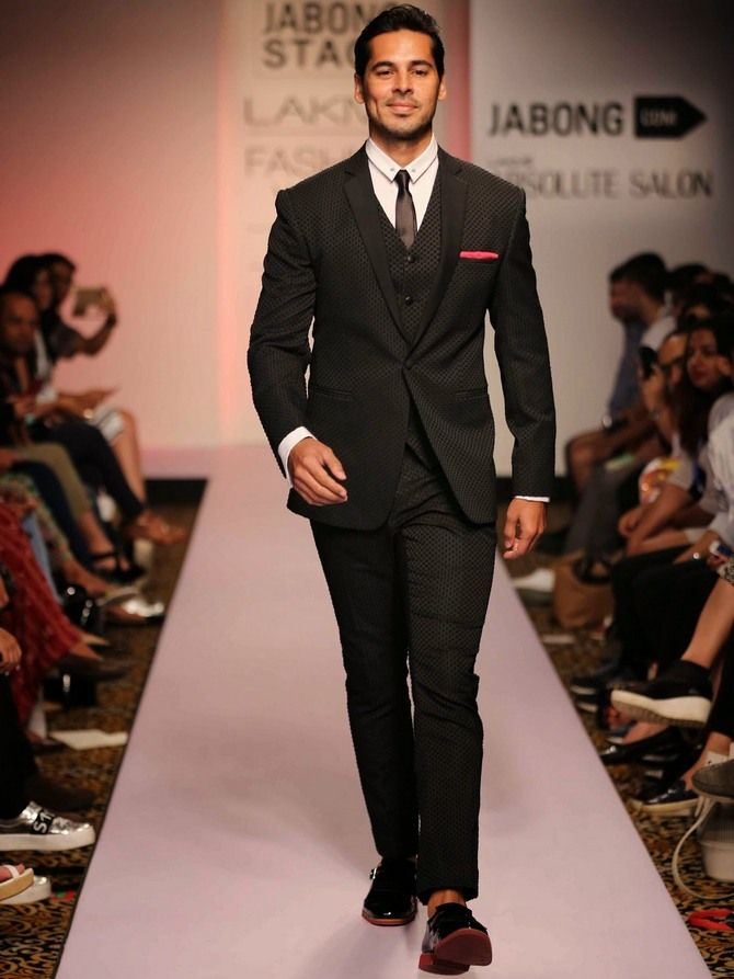 Here Dino Morea is modelling for designer Sahil Aneja and evidently enjoying every moment of it.
