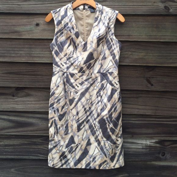 Grey print Ann Taylor petite dress Fully lined grey print dress. Side pockets. Interested pleats at neckline. Waist measures 14 inches. 19 inches waist to hem. Ann Taylor Dresses