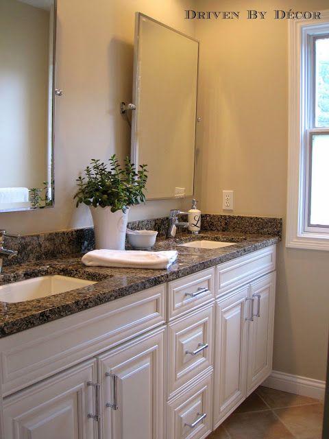 Kids' Bathroom: Granite countertop    white cabinets    Restoration Hardware mirrors