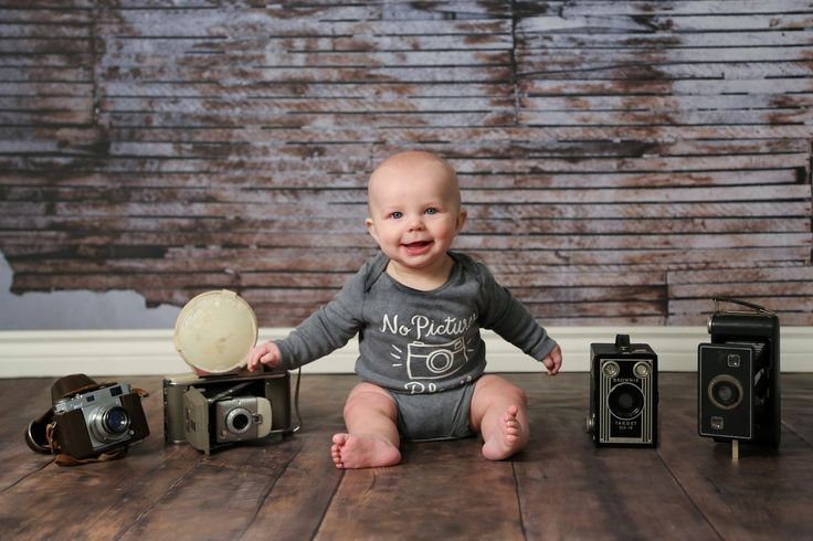 Photographer in the making! 6 month baby photo with antique camera by The Documentarians Photography