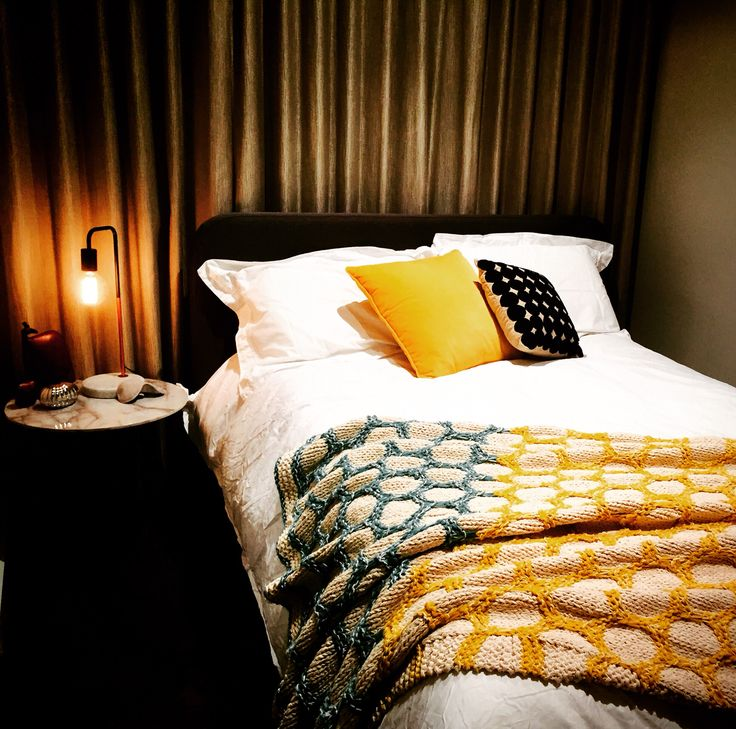 Guest room with mid-century mustard yellow highlights