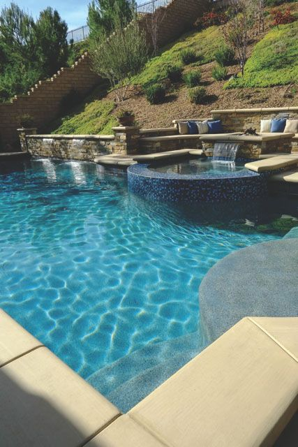 Pool with seating area and retaining wall built into for Pool design hillside