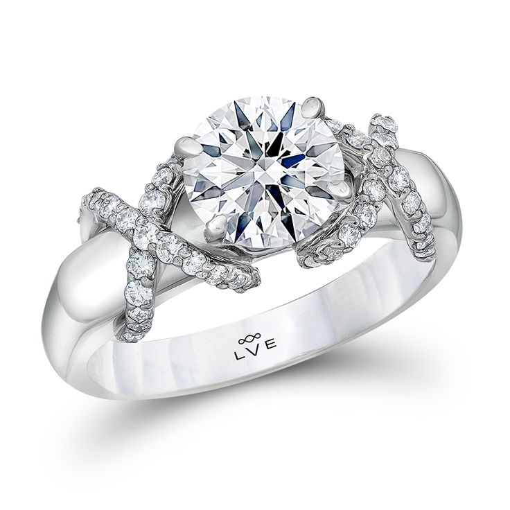 Diamond engagement ring features a 1.5 ct. Triple Zero(R) round brilliant  diamond