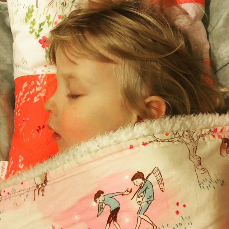 Sleeping beauty girl wrapped up in her MyMinkyMoo snuggle blanket & personal cushion. Buy yours today