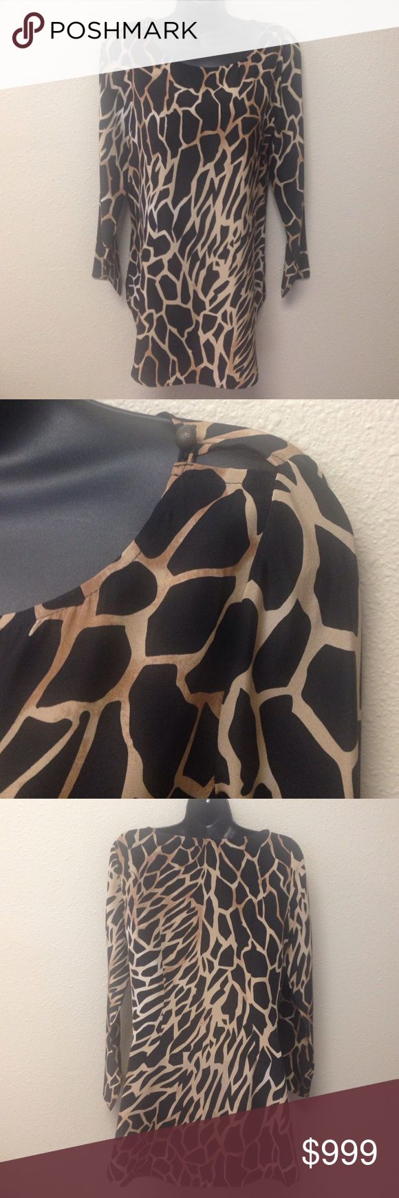 """Neiman Marcus Exclusive 100% Silk Tunic or Dress Perfect condition.  Neiman Marcus Exclusive.  Black and tan animal print dress or tunic.  100% Silk, cute button detail at each shoulder, long sleeves, rounded hem with side slits, crew neck.  Approx measurements laying flat:  chest 18.5"""", length 30"""". Neiman Marcus Exclusive Dresses"""