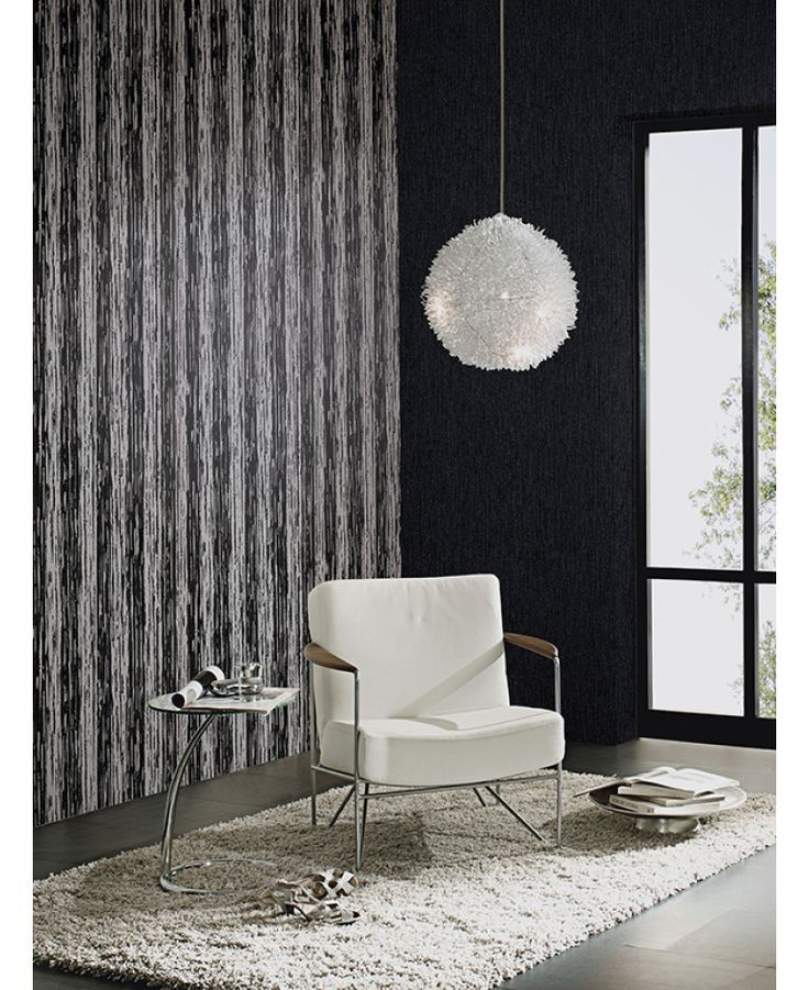 This Bark Glitter Wallpaper in black, grey and silver features a contemporary pattern infused with subtle glitter. Free UK delivery available