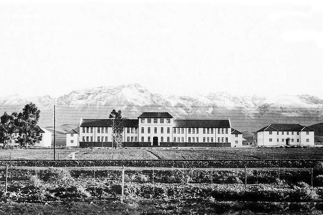 School for the Deaf in Worcester newly built in 1881 with snowy mountains in the background