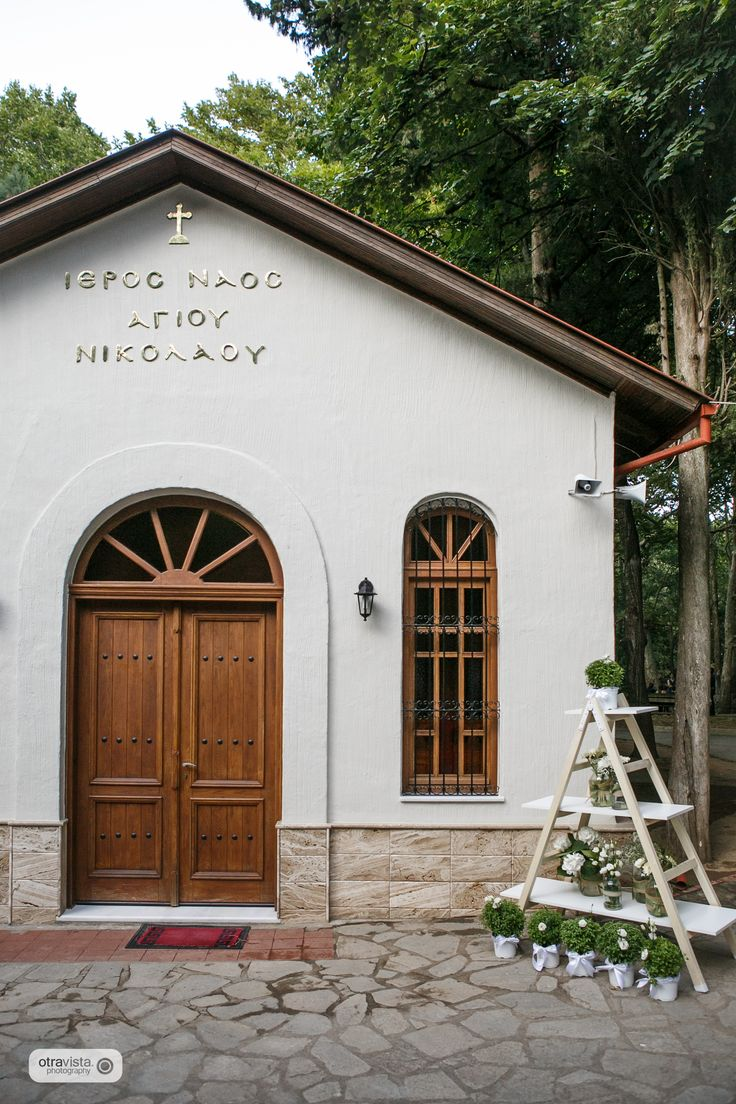 Rustic wedding in the countryside. Olive and white color palette. Church entrance with basels.