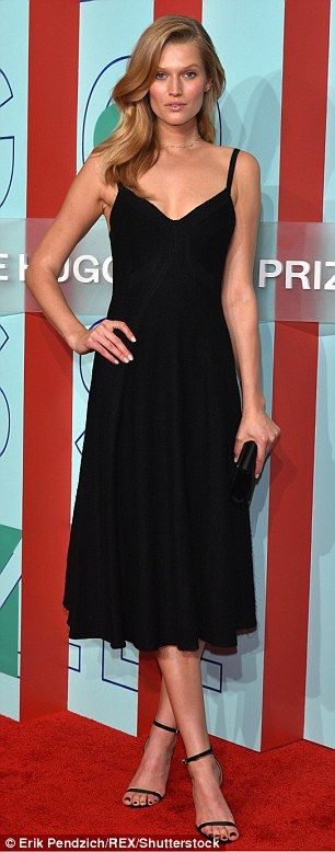 Model figure:Model Toni Garrn looked lovely in a floaty black dress...